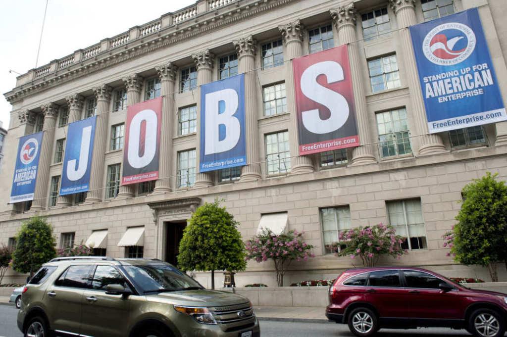"A giant sign reading ""jobs"" hangs outside the U.S. Chamber of Commerce building in Washington in 2011."