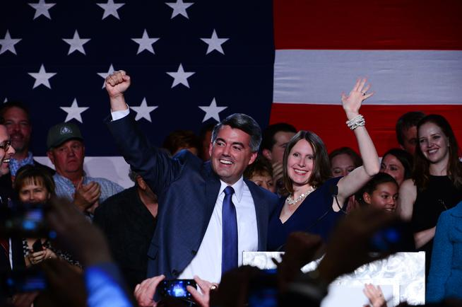 Republican Cory Gardner waves with his wife Jamie after winning the midterm elections in Denver, Colorado,