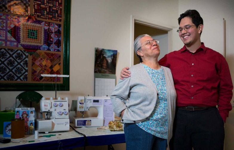 Eridani Alcantar, a UT graduate and high school math teacher, attributes his success to his mother, Esther, who put his education first.