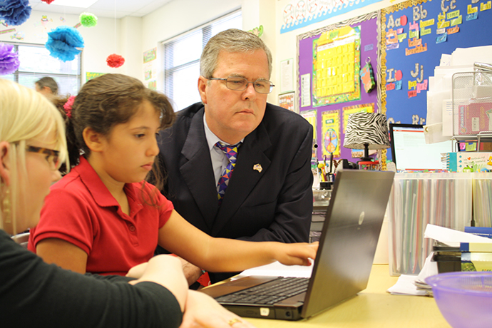 Governor Bush with a student during a visit to Reasoning Mind