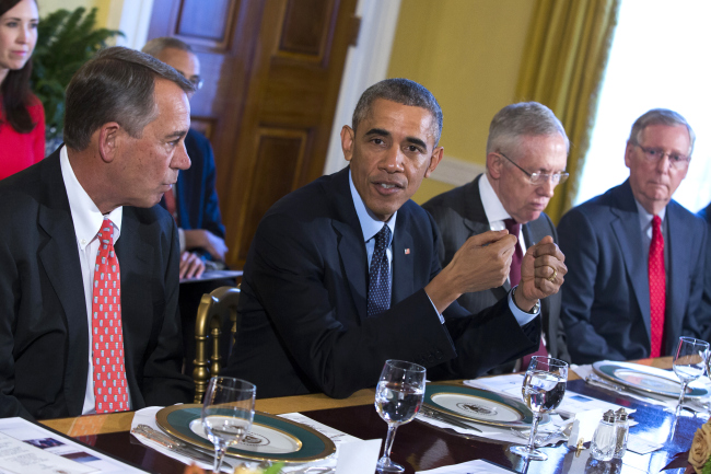 President Barack Obama meets with Congressional leaders in the Old Family Dining Room of the White House in Washington.