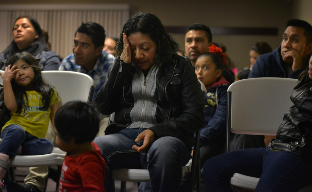 As her children grow restless around her, Marilu becomes overwhelmed by emotions while attending an event organized by a local immigration activist, where she addressed the audience about the effects of her husband being deported.