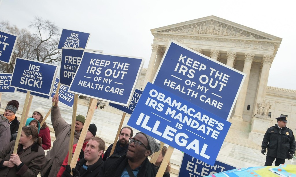 "Protestors hold placards challenging ""Obamacare"" outside of the US Supreme Court on March 4, 2015 in Washington, DC. The US Supreme Court faces a momentous case Wednesday on the sweeping health insurance reform law that President Barack Obama wants to leave as part of his legacy. The question before the court is whether the seven million people or more who subscribed via the government's website can obtain tax subsidies that make the coverage affordable. A ruling is expected in June.     AFP PHOTO/MANDEL NGANMANDEL NGAN/AFP/Getty Images"