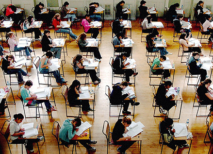 File photo dated 10/06/05 of exams in progress. England's exams system needs overhauling as top grades 'no longer automatically mean top students', the former boss of a major awarding body said today.