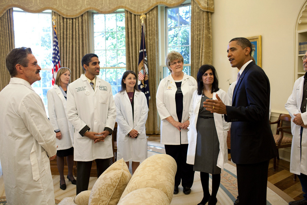 President Barack Obama greets doctors from around the country in the Oval Office, Oct. 5, 2009, prior to a health insurance reform event at the White House in Washington, D.C. (Official White House Photo by Pete Souza) This official White House photograph is being made available only for publication by news organizations and/or for personal use printing by the subject(s) of the photograph. The photograph may not be manipulated in any way and may not be used in commercial or political materials, advertisements, emails, products, promotions that in any way suggests approval or endorsement of the President, the First Family, or the White House.