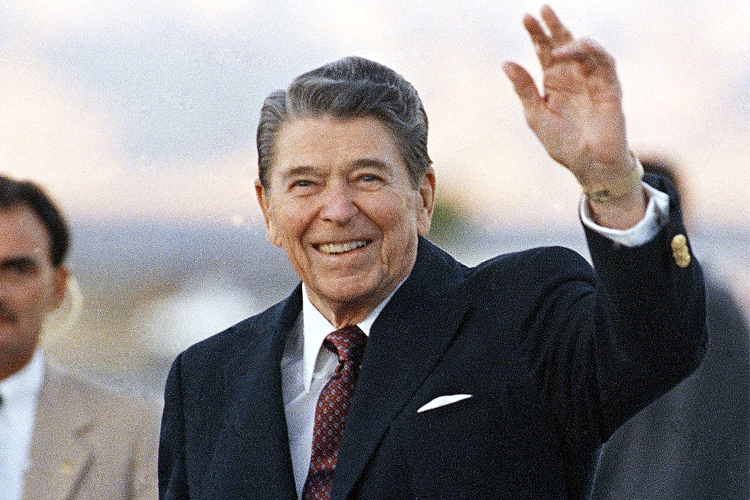 FILE - In this Dec. 29, 1988, file photo President Ronald Reagan waves to onlookers as he arrived in Palm Springs, Calif. If your're a fan of former President Ronald Reagan and you live in Wisconsin, you'll get a new day starting next winter to celebrate. A provision in the state budget that takes effect July 1, 2011, establishes Feb. 6 as Ronald Reagan Day. It's a symbolic measure to celebrate the Gipper's birthday and has no impact on state spending. (AP Photo/Doug Mills, File)