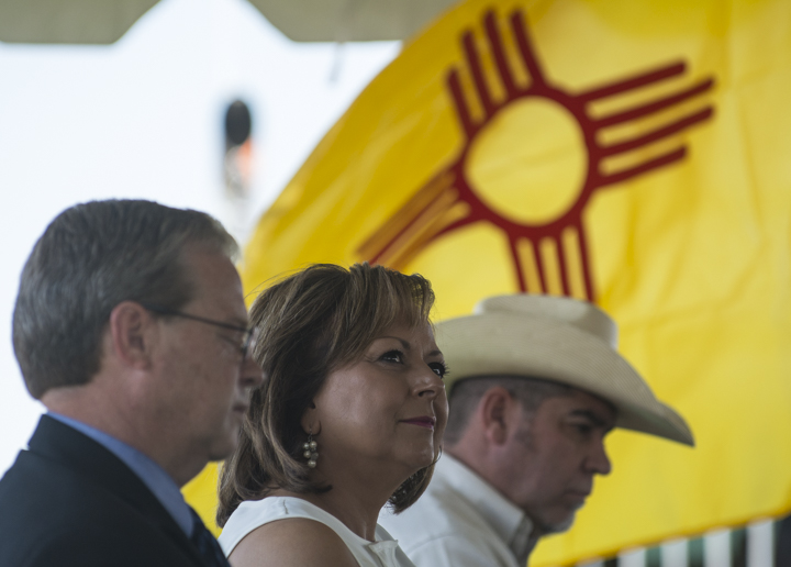 Gov. Susana Martinez, middle, listens to one of the speakers during the press conference.
